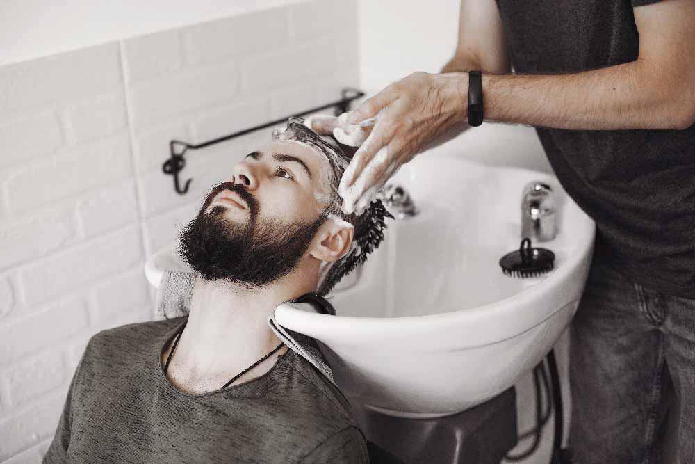 stylish-man-sitting-in-a-barbershop-98G645V.jpg